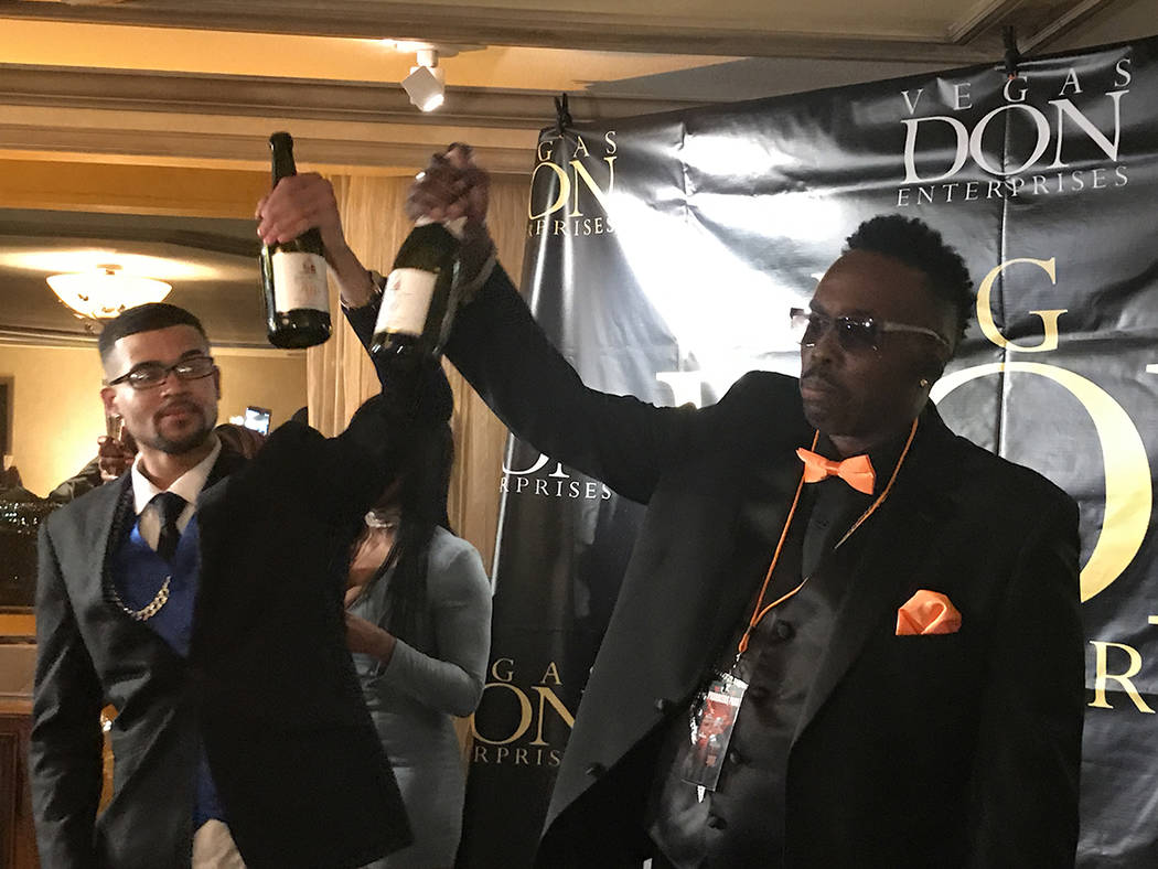 """Filmmaker and rapper Robert Strawder (right) toasts with co-star Anderson Hunt Jr. April 27 inside the Suncoast before the Las Vegas Black Film Festival featured Strawder's movie, """"C ..."""