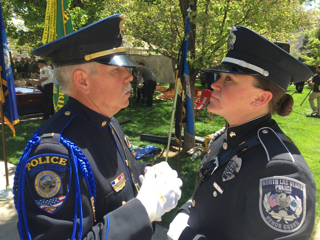 Lt. Brian Nebeker with the Clark County School District, and Kristen Bishop an officer with the North Las Vegas Police, inspect each other before the 2017 Nevada Law Enforcement Officers Memorial  ...