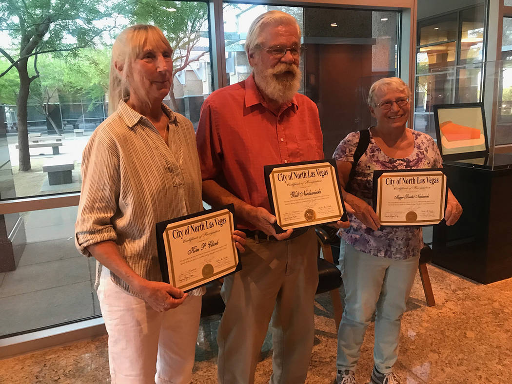 "Kim Clark, left, Walt Niedzwieckicq and Loretta ""Maggie"" Niedzwieckicq pose for photos with their certificates of appreciation May 3 at City Council meeting at the North Las Vegas City Hall, 2 ..."