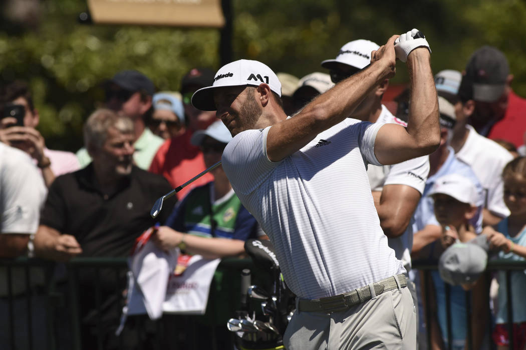 Dustin Johnson warms up on the driving range during practice rounds at the Wells Fargo Championship at Eagle Point golf course on Tuesday May 2, 2017 in Wilmington, N.C. (Ken Blevins/StarNews via AP)