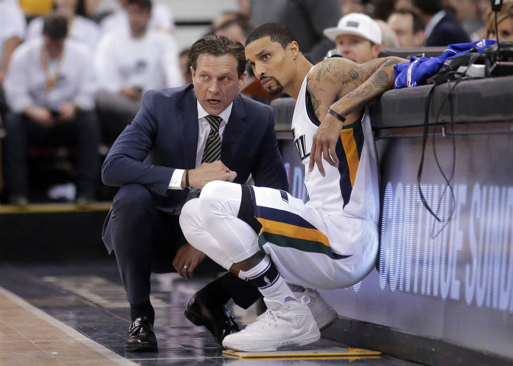 In this April 28, 2017, file photo, Utah Jazz coach Quin Snyder and George Hill speak during the first half in Game 6 of the team's NBA basketball first-round playoff series against the Los Angele ...