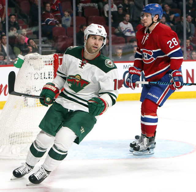 Dec 22, 2016; Montreal, Quebec, CAN; Minnesota Wild left wing Jason Zucker (16) scores a goal in an empty net during the third period and Montreal Canadiens defenseman Nathan Beaulieu (28) at Bell ...