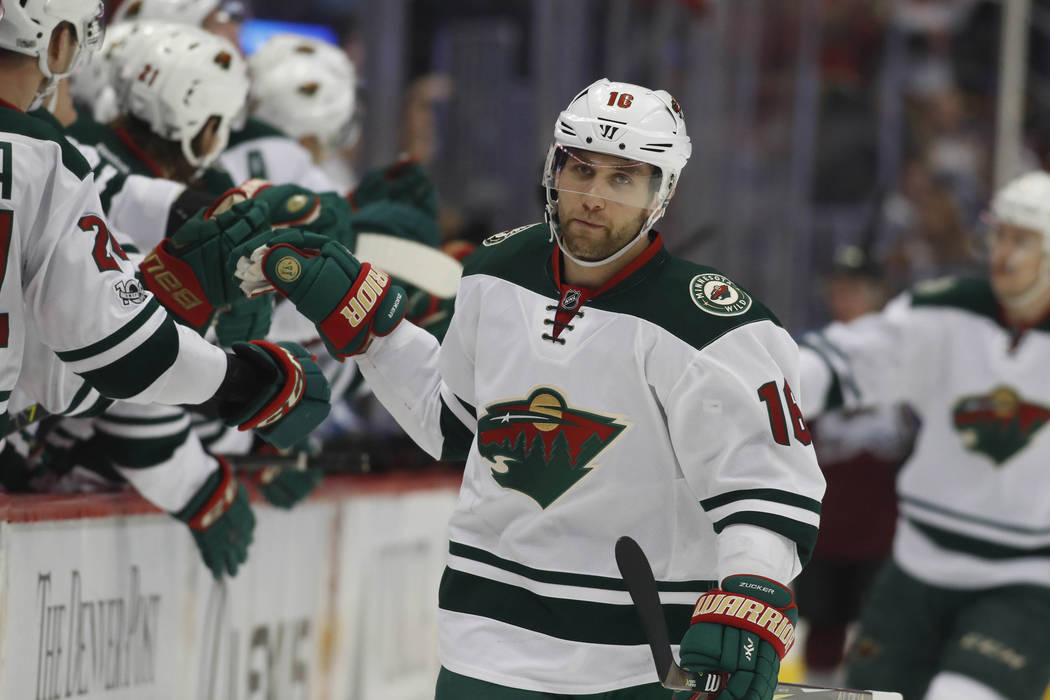 Minnesota Wild left wing Jason Zucker (16) in the first period of an NHL hockey game Thursday, April 6, 2017, in Denver. (AP Photo/David Zalubowski)