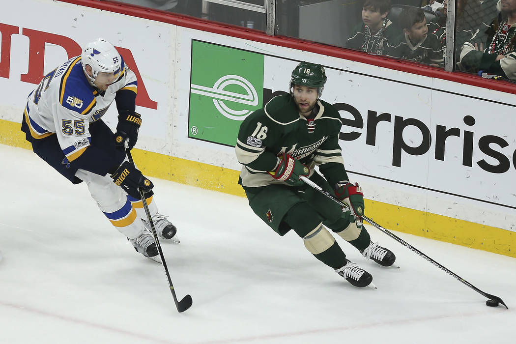 Minnesota Wild's Jason Zucker (16) looks to pass the puck against St. Louis Blues' Colton Parayko (55) during the third period of Game 2 of an NHL hockey first-round playoff series Friday, April 1 ...