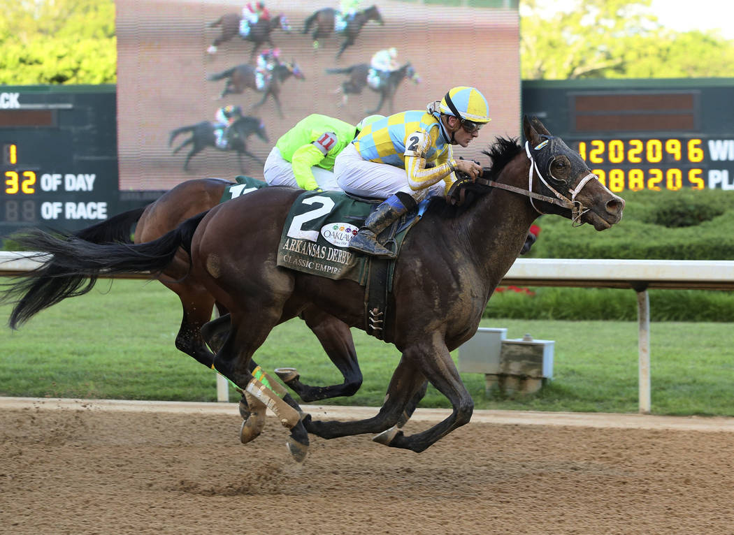 In a photo provided by Oaklawn Park, Classic Empire and jockey Julien R. Leparoux win the Arkansas Derby horse race Saturday, April 15 2017, at Oaklawn Park in Hot Springs, Ark. (Coady Photography ...