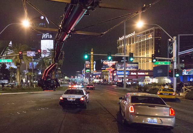 "A camera rig follows a chase scene down the Strip for a scene from ""Jason Bourne."" The film is one of the few to be shot in Nevada since film tax credits were removed in 2015. (Courtesy Universal  ..."