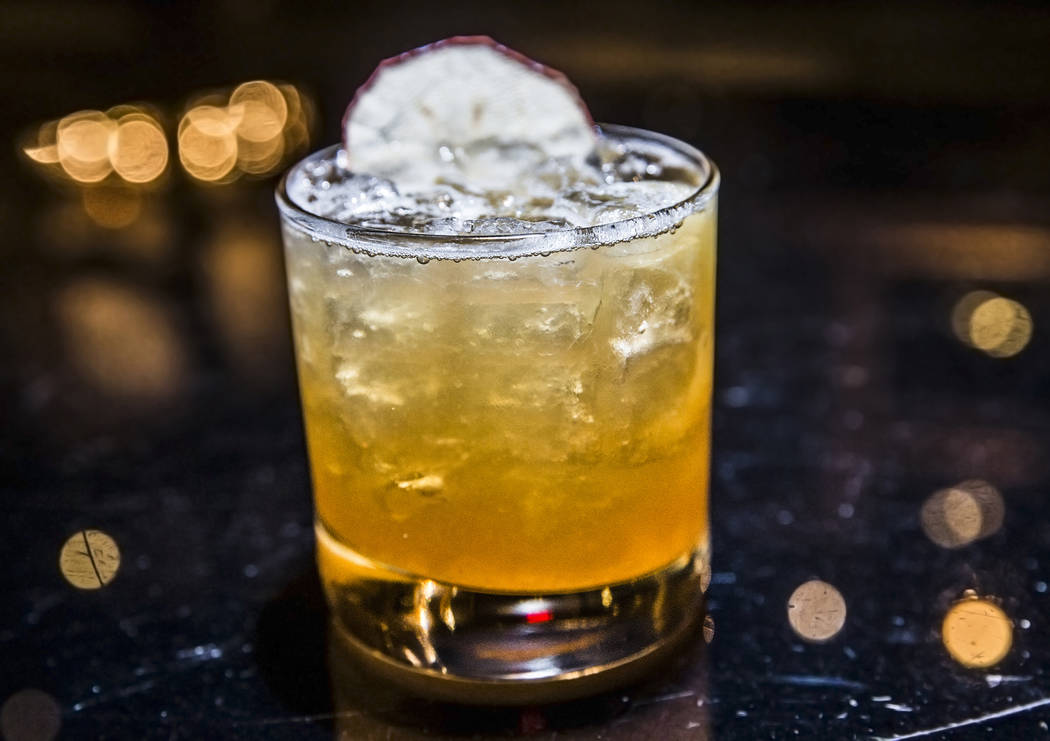 The Woodsman, with Makers 46, allspice dram, maple syrup, lemon juice, pear, apple chip at Beauty & Essex on Wednesday, May 3, 2017, at The Cosmopolitan hotel-casino, in Las Vegas. Benjamin Ha ...