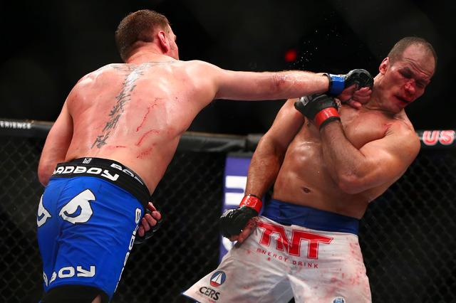 Stipe Miocic hits Junior Dos Santos during UFC Fight Night at US Airways Center in Phoenix on Saturday night. (Mark J. Rebilas-USA TODAY Sports)