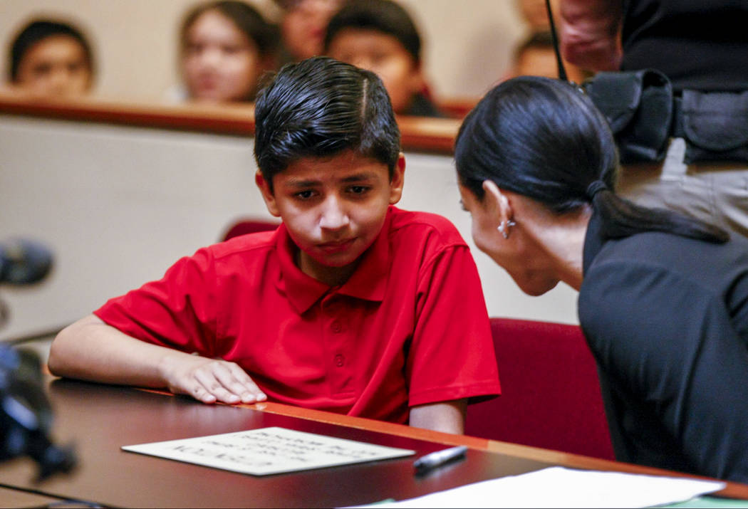 "Attorney Ivette Maningo talks with Fransisco Munoz, the defendant, in a mock trial as a part of the ""Kids in the Court"" program at the North Las Vegas Justice Court on Tuesday, M ..."
