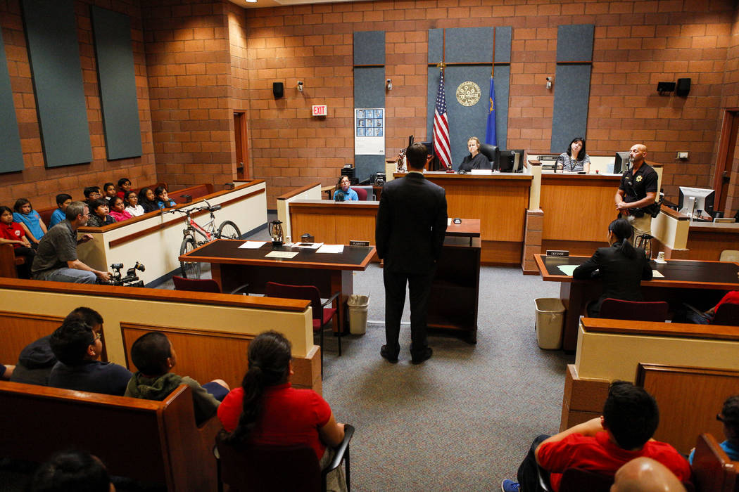 Christopher Pandelis, chief deputy district attorney, examines Zitlalic Salinas, the plaintiff and a fifth grader from C.P. Squires Elementary School, during a mock trial as a part of the &quo ...