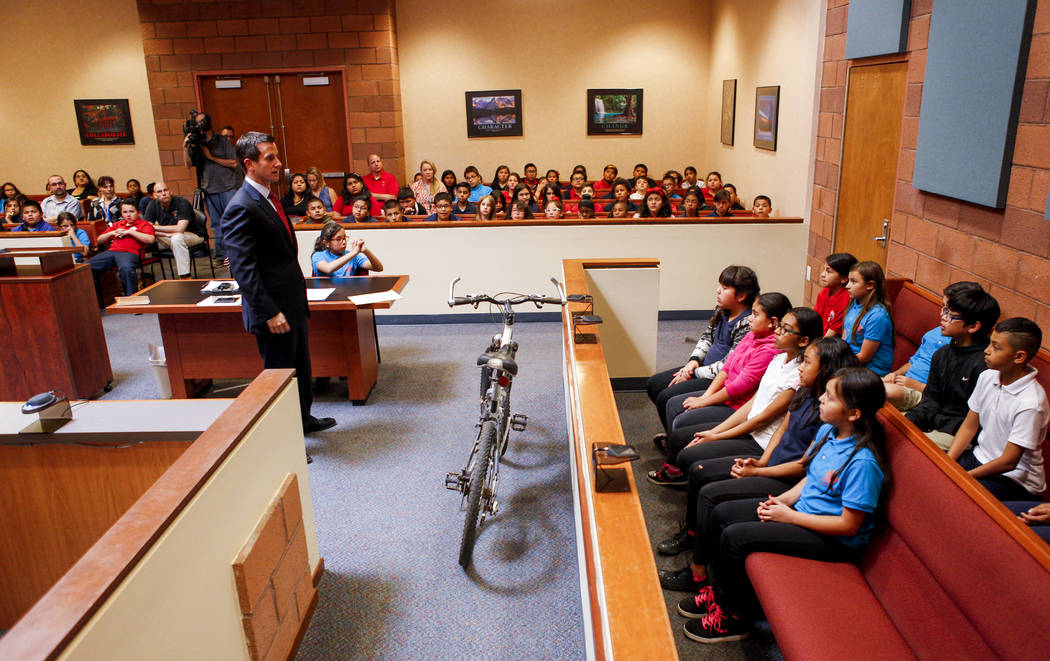 Christopher Pandelis, chief deputy district attorney, presents his closing statements to the jury, comprised of fifth graders from C.P. Squires Elementary School, during a mock trial as a part of  ...