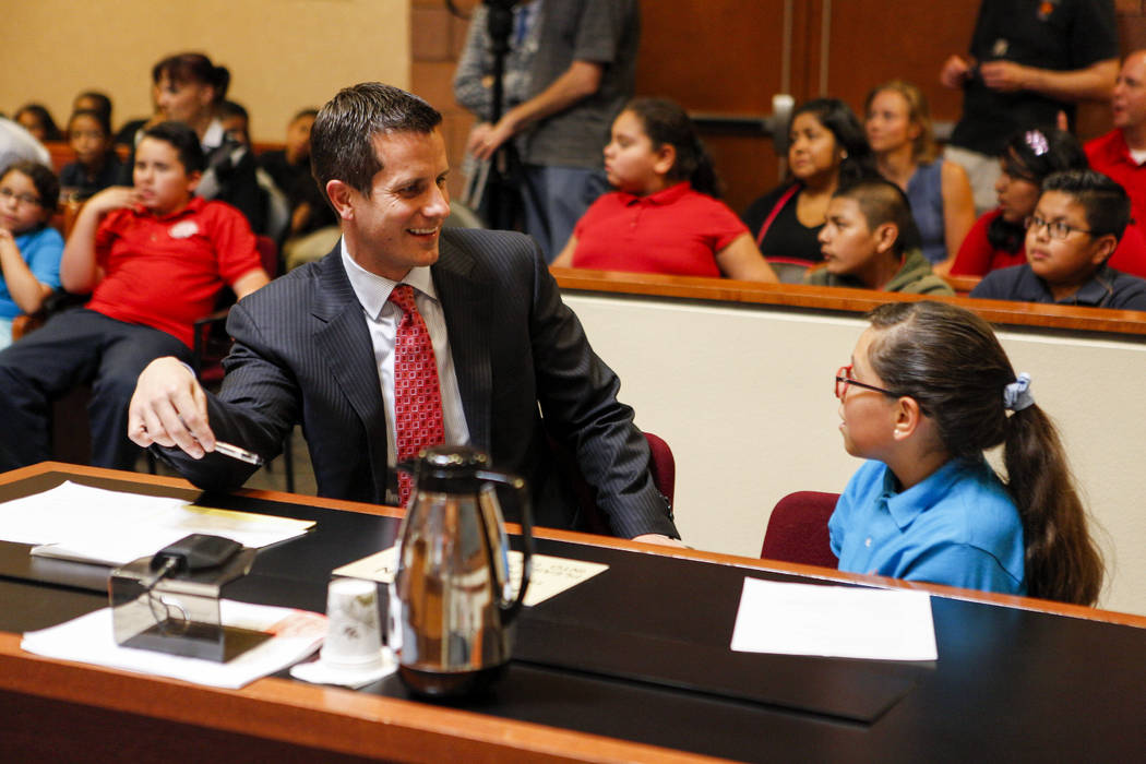 Christopher Pandelis, chief deputy district attorney, talks with Zitlalic Salinas, the plaintiff and a fifth grader from C.P. Squires Elementary School, following a mock trial as a part of the &am ...