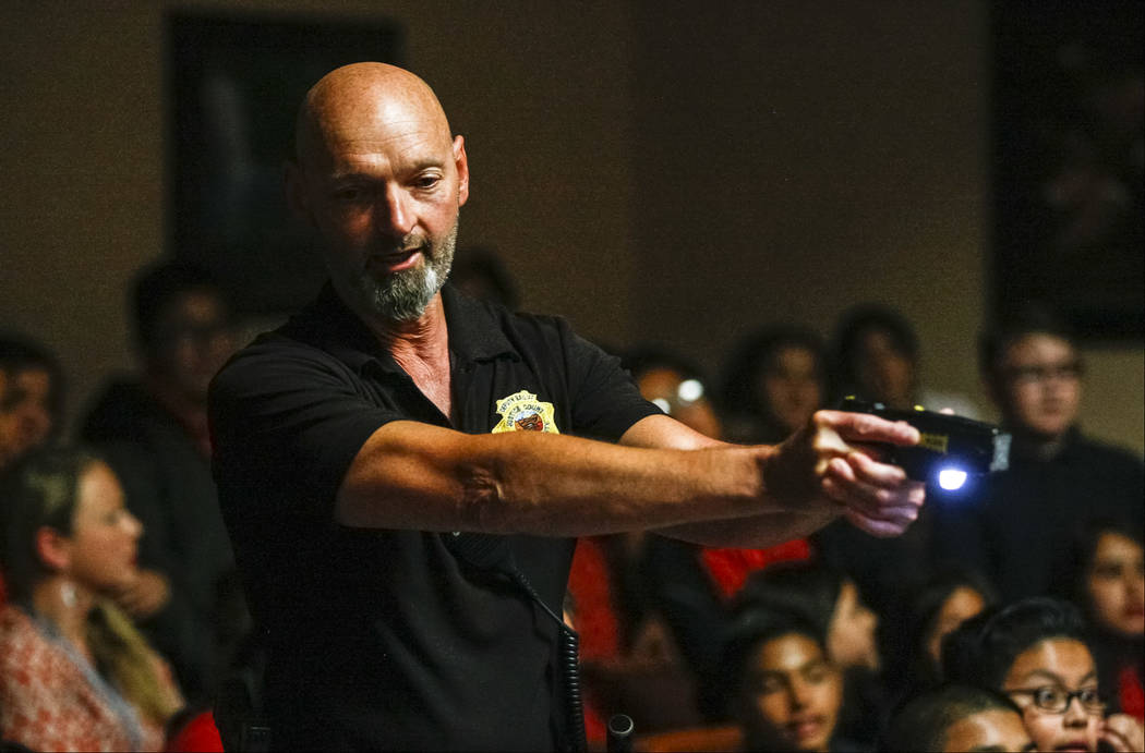 Ron Wright, judicial bailiff for Judge Natalie Tyrrell, gives a demonstration on his taser with fifth graders from C.P. Squires Elementary School at the North Las Vegas Justice Court on Tuesday, M ...