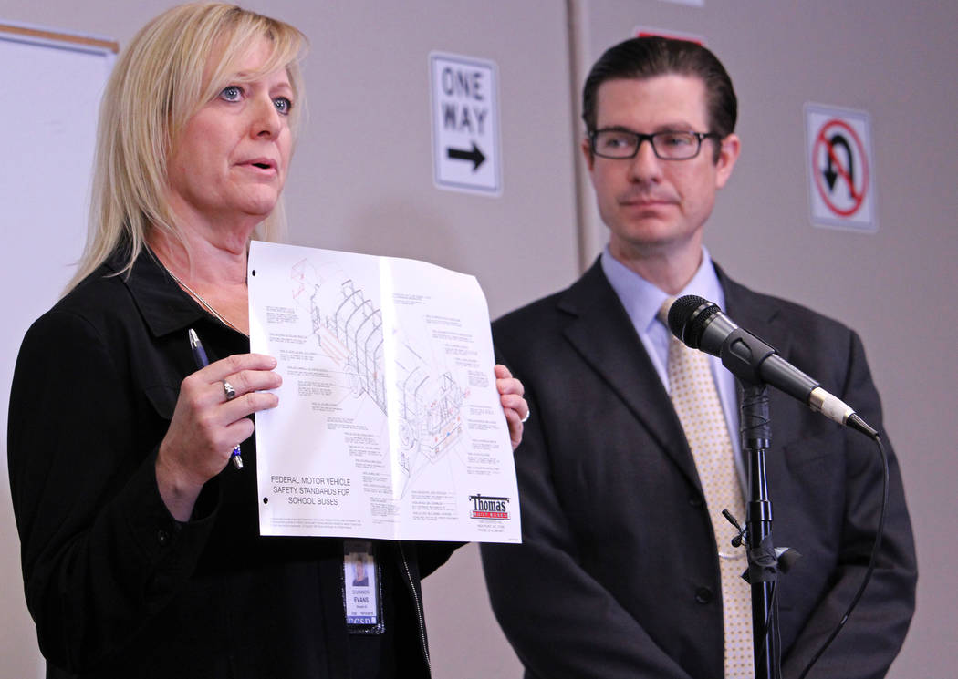 "CCSD official Shannon Evans, left, holds up a diagram that explains how safe school buses are on Friday, May 5, 2017. ""They're like rolling cages,"" Evans said. Gabriella Benavidez Las Vegas Review ..."