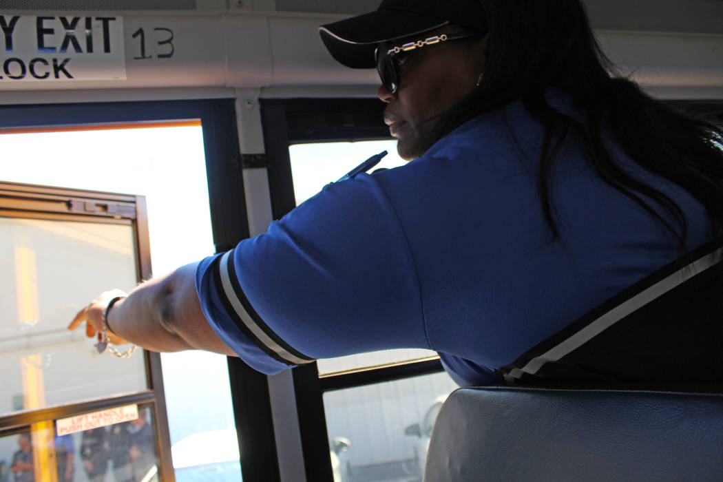 Clark County School District transportation investigator Trina Tatum opens an emergency window on a school bus, Friday, May 5, 2017. Gabriella Benavidez Las Vegas Review-Journal @latina_ish