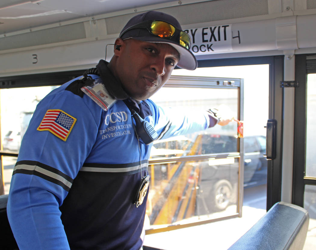 Clark County School District transportation investigator Jovan Mingo opens an emergency window on a school bus, Friday, May 5, 2017. Gabriella Benavidez Las Vegas Review-Journal @latina_ish
