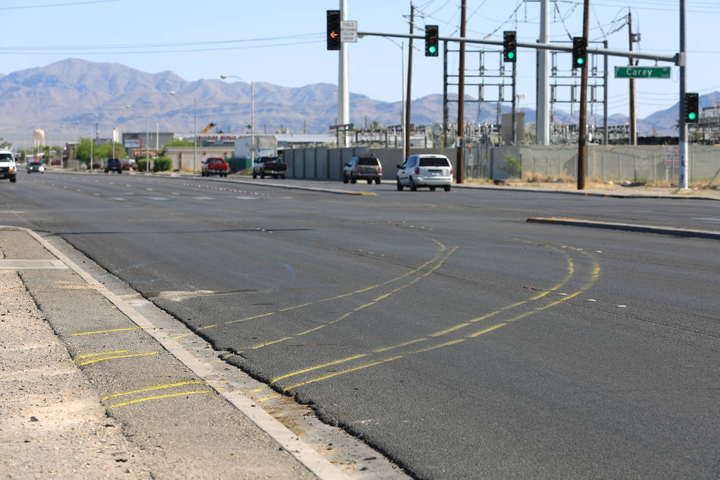 Yellow paint marks the path of a school bus that rolled over colliding with a sedan on Friday, May 5, 2017, in Las Vegas. The crash killed one person who was not on the bus. Brett Le Blanc Las Veg ...
