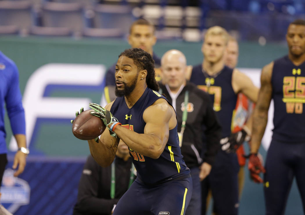 Arkansas wide receiver Keon Hatcher runs a drill at the NFL football scouting combine in Indianapolis, Saturday, March 4, 2017. (AP Photo/Michael Conroy)