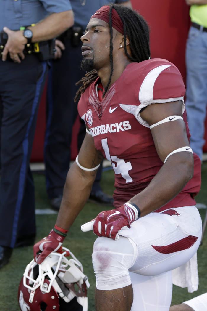Arkansas wide receiver Keon Hatcher kneels on the sideline after an NCAA college football game in Little Rock, Ark., Saturday, Sept. 12, 2015. Toledo defeated Arkansas 16-12. (AP Photo/Danny Johnston)