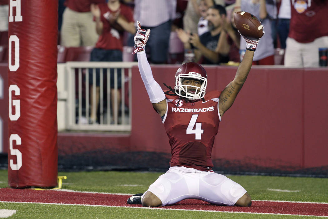 FILE - In this file photo taken Sept. 20, 2014, Arkansas wide receiver Keon Hatcher celebrates his fourth-quarter touchdown in an NCAA college football game against Northern Illinois in Fayettevil ...