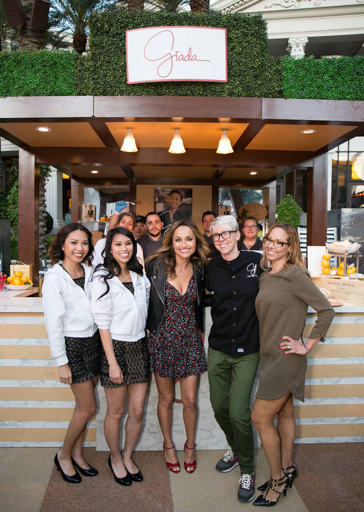 Giada De Laurentiis, center, and her team from her restaurant Giada at The Cromwell take part in The Grand Tasting at Caesars Palace during Vegas Uncork'd on Friday, April 28, 2017, in Las Vegas.  ...
