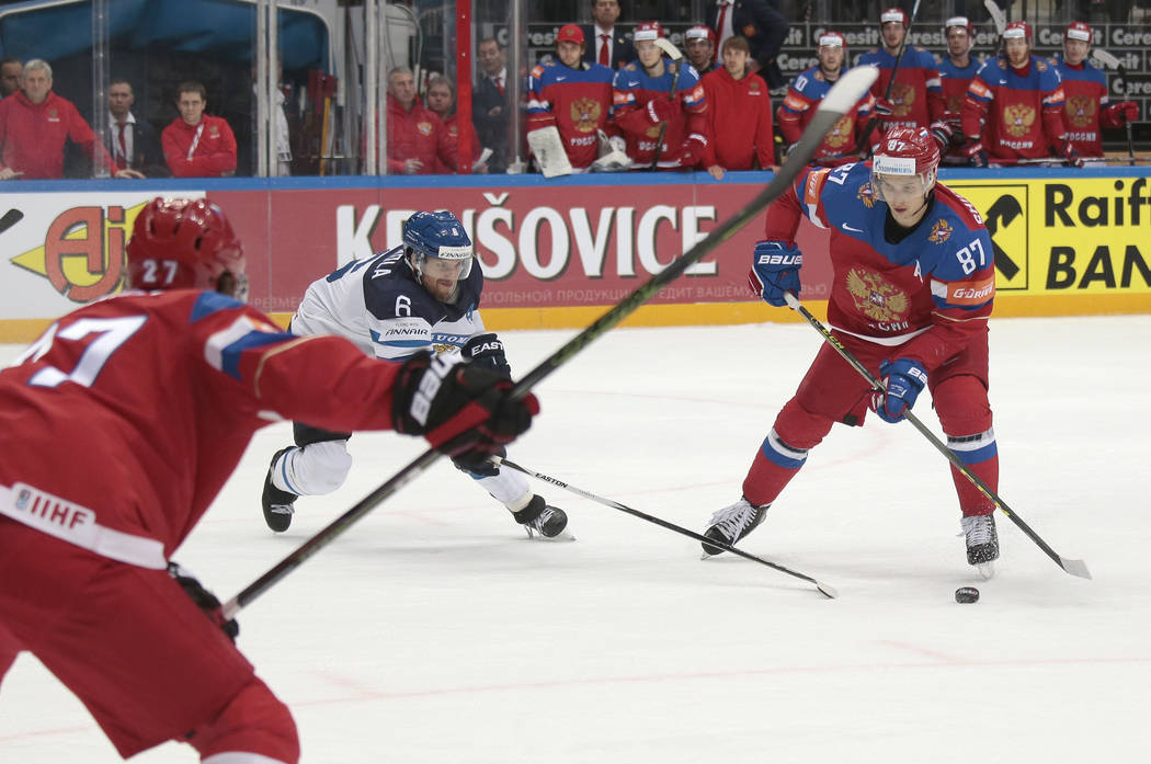Russias Vadim Shipachyov, right, challenges for the puck with Finlands Topi Jaakola, left, during the Ice Hockey World Championships semifinal match between Finland and Russia, in Moscow, Russia,  ...