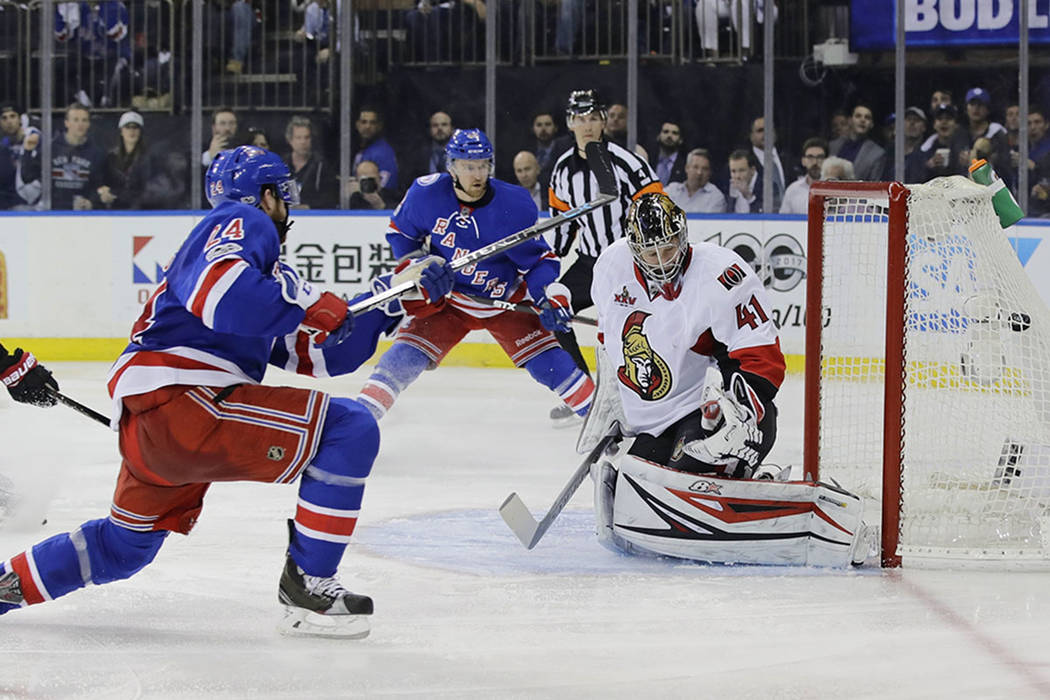 New York Rangers' Oscar Lindberg (24) shoots the puck past Ottawa Senators goalie Craig Anderson (41) during the second period of Game 4 of an NHL hockey Stanley Cup second-round playoff series Th ...