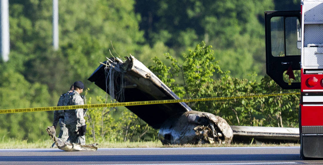 Part of a cargo plane lays on the ground following a fatal crash at Yeager Airport in Charleston, W. Va., Friday, May 5, 2017. The plane contracted by UPS went off the runway and over a hillside a ...