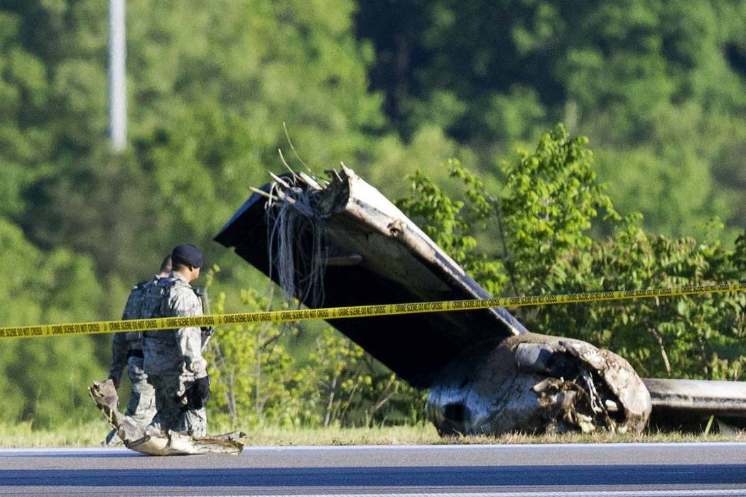 Part of a cargo plane lays on the ground following a fatal crash at Yeager Airport in Charleston, W.Va., Friday, May 5, 2017. The plane contracted by UPS went off the runway and over a hillside at ...