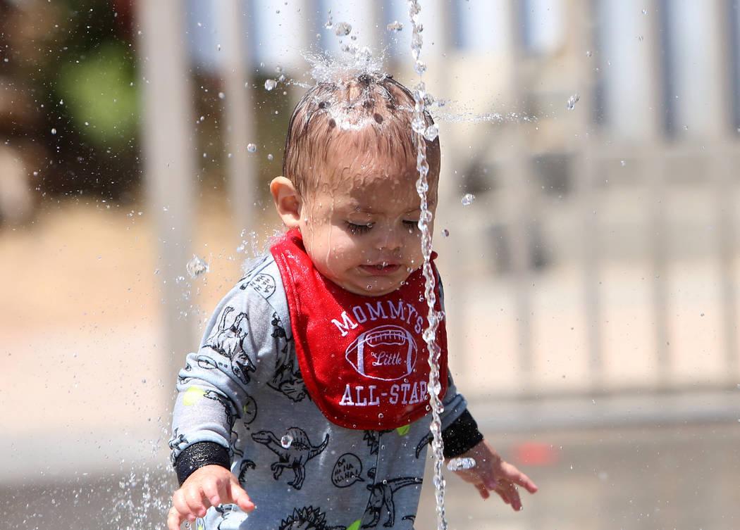 One-year-old Noa Ceniceros cools himself while playing at Lorenzi Park on Friday, May 5, 2017, in Las Vegas. Bizuayehu Tesfaye Las Vegas Review-Journal @bizutesfaye