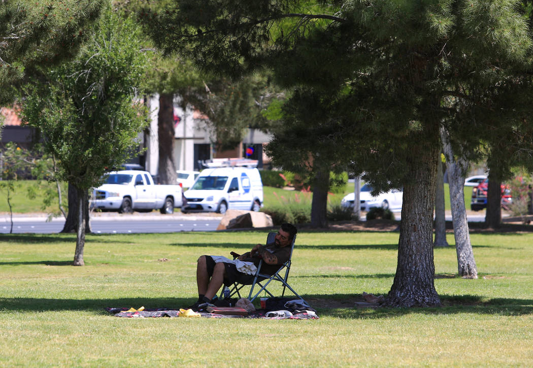 A man takes a nap in the shade of a tree in Sunset Park on Friday, May 5, 2017, in Las Vegas. Brett Le Blanc Las Vegas Review-Journal @bleblancphoto