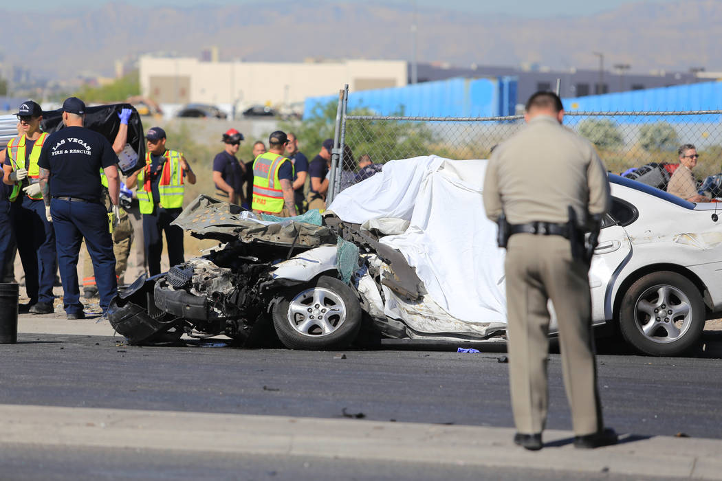 Emergency personnel work the scene of a crash involving a rolled over school bus on Thursday, May 4, 2017, in Las Vegas. Brett Le Blanc Las Vegas Review-Journal @bleblancphoto