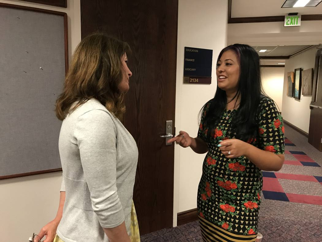 Justeen Beal, right, speaks with Misty Vaughan Allen, state suicide prevention coordinator, on Friday, May 5, 2017 at the Nevada Legislature after a Senate committee approved a bill requiring heal ...