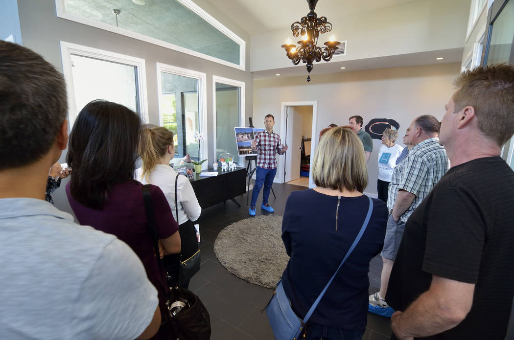 Craig Palacios, a principal with Bunnyfish Studios, talks about the work he and his team did restoring the Phoenix House from a burned out shell during a tour of the home on Saturday, April 29, 20 ...