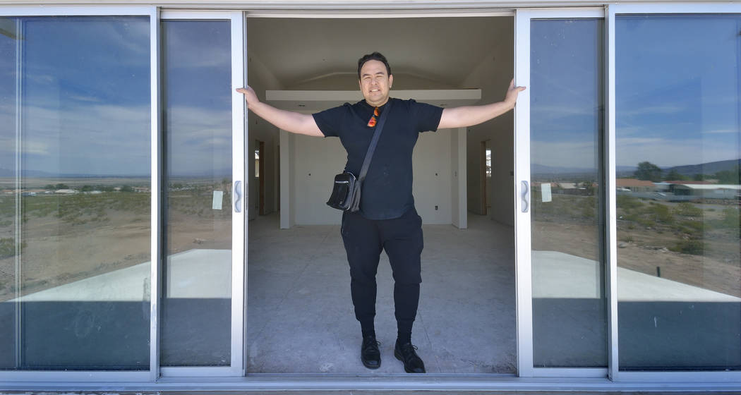 Designer Aeron Tozier is shown in a custom home he built at 328 N. Lisbon St. in Henderson. (Bill Hughes Real Estate)