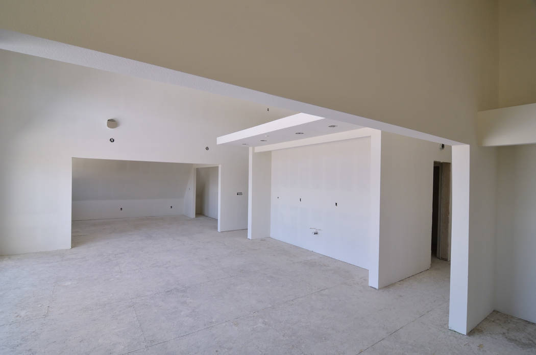The arch structure of the residence allows for 3,170 square feet of available living space that includes four bedrooms, three baths, two living rooms, kitchen, dining room, office area and workout ...