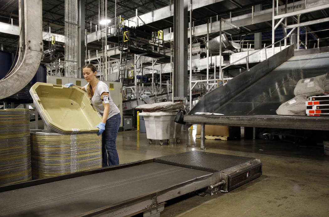 In this Nov. 20, 2015, photo, a UPS employee works inside the company's Worldport hub in Louisville, Ky. On Friday, May 5, 2017, the U.S. government issues the April jobs report. (AP Photo/Patrick ...