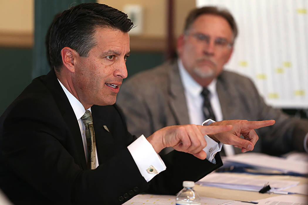 Gov. Brian Sandoval with his chief of staff Mike Willden, right. (Cathleen Allison/Las Vegas Review-Journal)