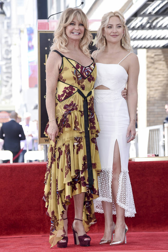 Goldie Hawn and Kate Hudson attend a ceremony honoring Goldie Hawn and Kurt Russell with stars on the Hollywood Walk of Fame on Thursday, May 4, 2017, in Los Angeles. (Richard Shotwell/Invision/AP)