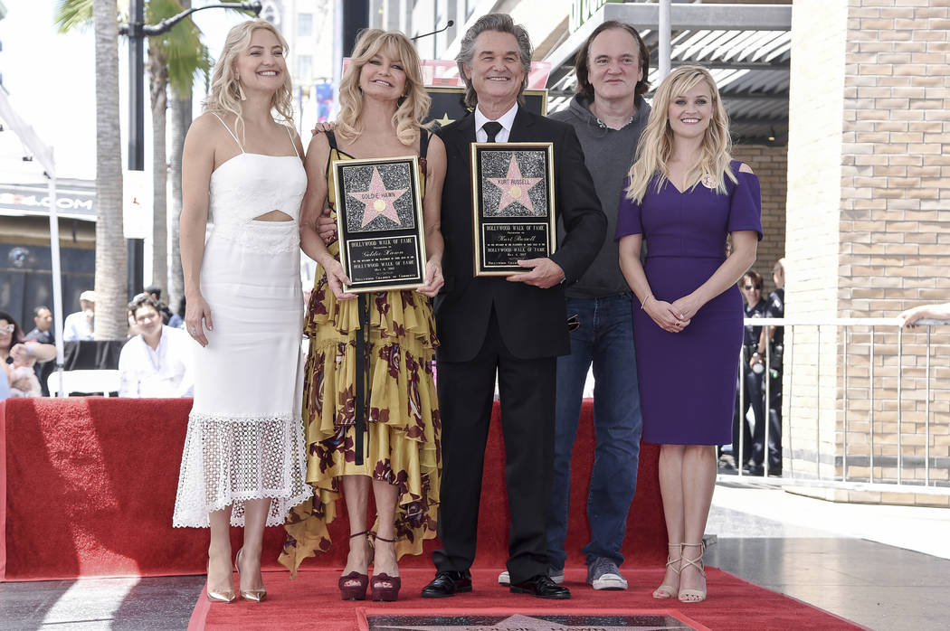 Kate Hudson, from left, Goldie Hawn, Kurt Russell, Quentin Tarantino and Reese Witherspoon attend a ceremony honoring Hawn and Russell with stars on the Hollywood Walk of Fame on Thursday, May 4,  ...