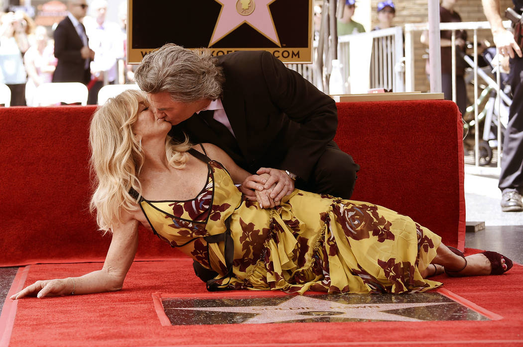 Goldie Hawn and Kurt Russell kiss at a ceremony honoring the couple each with stars on the Hollywood Walk of Fame on Thursday, May 4, 2017, in Los Angeles. (Richard Shotwell/Invision/AP)