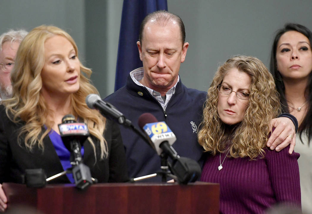 Jim and Evelyn Piazza stand by as Centre County District Attorney Stacy Parks Miller, left, announces the results of an investigation into the death of their son Timothy Piazza, a Penn State Unive ...