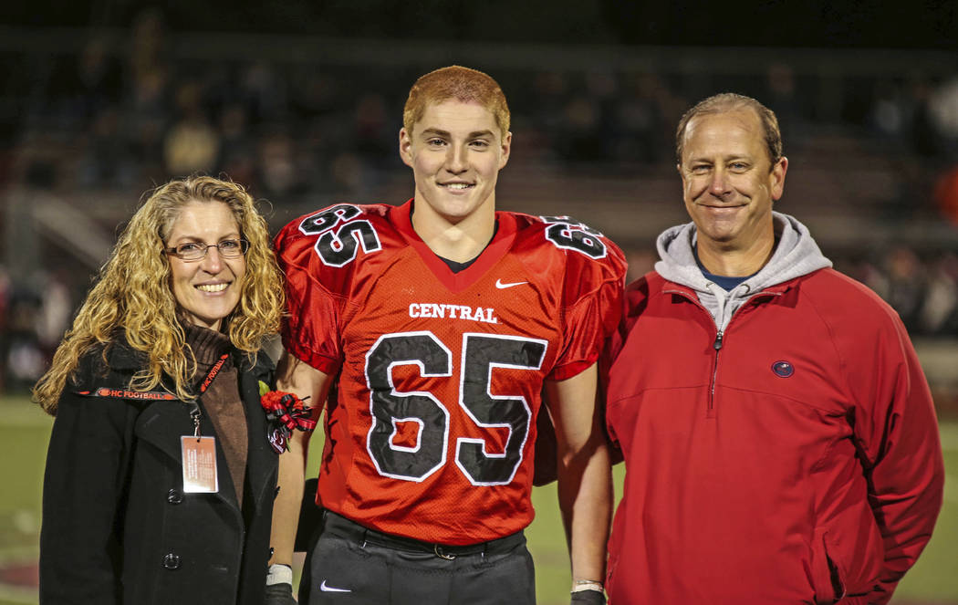 "Timothy Piazza, center, with his parents Evelyn Piazza, left, and James Piazza, right, during Hunterdon Central Regional High School football's ""Senior Night"" at the high school's stadium in Flemi ..."