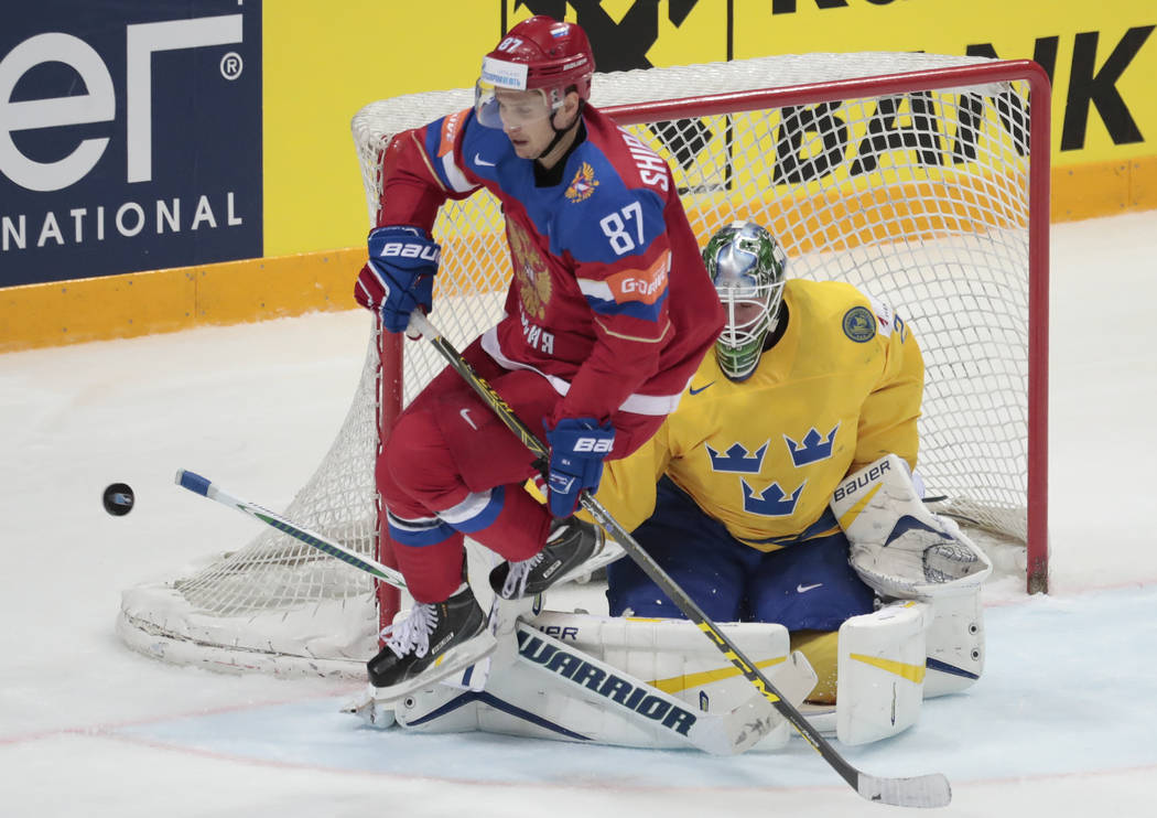 Russias Vadim Shipachyov jumps as Swedens goalie Jacob Markstrom makes a save during the Ice Hockey World Championships Group A match between Russia and Sweden, in Moscow, Russia, on Tuesday, May  ...
