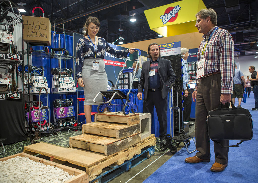 Bob Delain of Pico Rivera, California, right, looks at the Trolley Dolly at National Hardware Show at Las Vegas Convention Center on Wednesday, May 10, 2017. Patrick Connolly Las Vegas Review-Jour ...