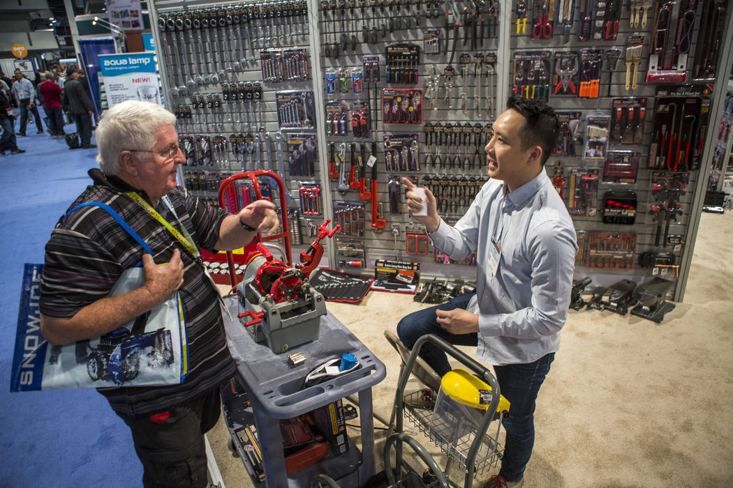 Donnie Tittle, a plumber from Henderson, left, talks with Jeffery Bao of King Tools & Equipment at the National Hardware Show at Las Vegas Convention Center on Wednesday, May 10, 2017. Patrick ...