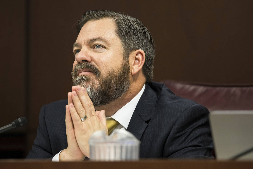 Senate Minority Leader Michael Roberson, R-Nev., listens to a colleague speak during the second day of the Nevada Legislative session on Tuesday, Feb. 7, 2017, at the Legislative Building, in Cars ...