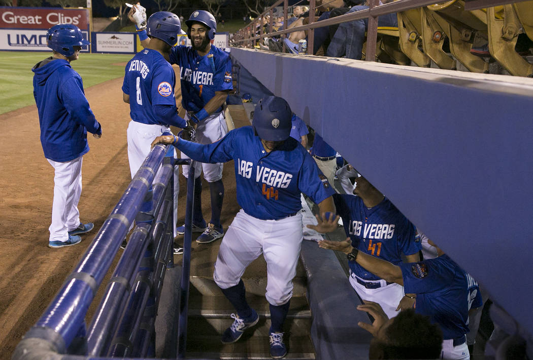 51s players Xorge Carrillo (44), center, and Desmond Jennings (8), second from left, are congratulated after a run in the second inning during a game against Albuquerque at Cashman Field on Thursd ...