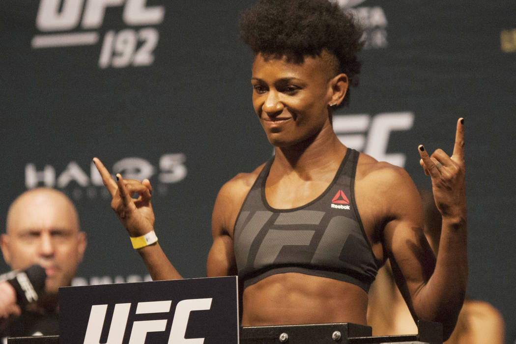 UFC fighter Angela Hill reacts after her weight was announced during the weigh in for UFC 192, Friday, Oct. 2, 2015 in Houston. (AP Photo/Juan DeLeon)
