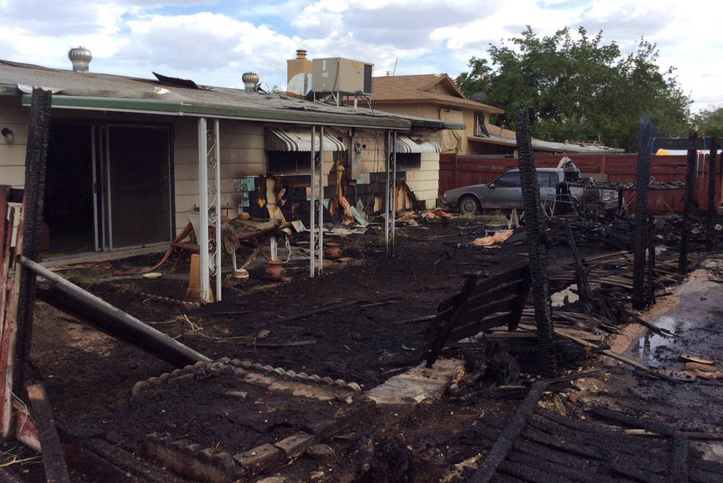 One person was taken to the hospital with serious burns after trying to put out a house fire Friday in central Las Vegas. (Las Vegas Fire Rescue/Twitter)
